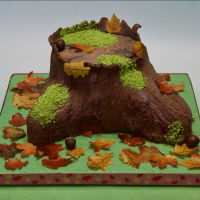 Autumn Stump Cake Everything is edible! Chocolate fudge cake with dark chocolate buttercream filling, covered with fondant. Fondant was then brushed with...