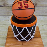 "Basketball Cake Cake for my son's PE coaches. All edible - even the ball! Three 8"" round luscious lemon cakes with vanilla buttercream filling..."