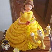 Belle - Beauty And The Beast Cake And Character Sculptings Belle's dress is the cake, she is placed on on cake board I made look like a hardwood floor and surrounded by her movie friends. All...