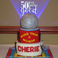 Cherie's 50Th Saturday Night Fever Themed Cake. The cake has flashing neon lighting on the floor & also around the base of the top disco ball cake.