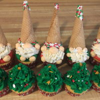 Christmas Gnome Cupcakes Ice Cream cone hats dipped in white chocolate and sprinkles. Cupcakes are caramel with caramel buttercream.