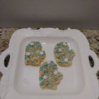 Christmas Mittens Rice Krispie treats with chocolate.