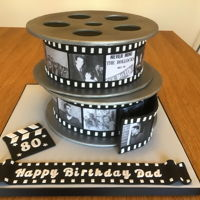 Dads 80Th Movie Reel Cake For my Dad's birthday with pictures of him and our family and his music choices over the years. He just loved it and spent ages...