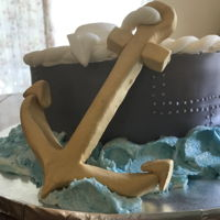 Navy Theme 90Th Birthday Cake Buttercream covered cake with gumpaste decorations including an anchor, a sailor's cap and a life preserver.