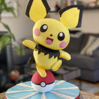 Pichu Pokemon Cake Finally figured out how to use threaded metal poles for cake structure. So excited for the new design possibilities.