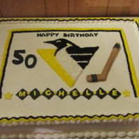 Pittsburgh Penguins Hockey Cake Full Sheet Cake frosted in buttercream with fondant decorations.