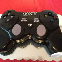 Playstation Remote Cake Cake carved into a PlayStation remote