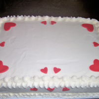 Red Hearts... Super easy one to do, customer had something for middle of cake.9x13 chocolate sheet cake, vanilla buttercream ,fondant hearts.