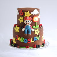 Super Mario A cake with chocolate ganache and a cute Super Mario figure.