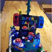 Switch, Mario, Luigi's Mansion Anti-Gravity Birthday Cake Hand sculpted Mario Brothers characters and switch.