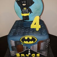 Batman Lego 8 inch square cake. 6inch depth. Vanilla cake with buttercream. Covered in fondant and hairbrushed.