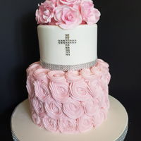 Christening/baptism 4 inch cake covered in fondant, 8 inch cake covered in pink buttercream. Gum paste roses.