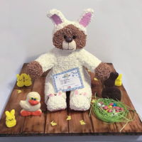 Build-A-Bear Easter Teddy Bunny 3D carved cake with fondant, chocolate, modeling chocolate accents. Wafer paper easter grass and bunnies . TFL!