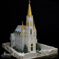 Gingerbread Church This gingerbread chapel is made from edible materials. It features a gingerbread wall and roof structure, candy window glass, fondant...