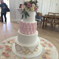 Wedding Cake This is a wedding cake created for this weekend. The triangles on the 3rd tier are made from gum paste. I had asked for help with them a...