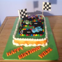 Wilde Turns 5!!! Favorite cars. Fondant cars and racetrack. M&M line the track. Fun cake for a 5 year old!