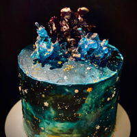 "Galaxy Cake 6"" galaxy themed cake, ""painted"" with buttercream. Toppers are melted hard candies poured over ice"