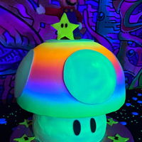 Glow Cake Mario Mushroom airbrushed with glow food coloring purchased from FairyDustCakesSupply on Etsy. These Lumo Paint glow colors are awesome!...