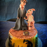 Harry Potter And Dobby Cake Harry Potter and Dobby cake for a 11 year birthday. The cake is made of chocolate cake, white chocolate filling and covered with fondant....