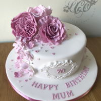 "Pretty Pink Flowers Vanilla sponge 8"" with a beautiful flower arrangement."
