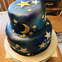 Starry Night Birthday Cake Fondant covered cake with gold and silver luster dust stars and moons.