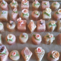 "Almond Petit Four Glace 1.5"" x 1.5"" three layer almond cakes, with alternating apricot and blackberry jam, then glazed with poured fondant icing."