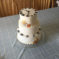 Friends For Time Cake 3 tiered white/almond cake covered in vanilla/almond buttercream w/MMF gears & numbers