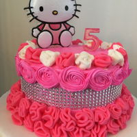 Hello Kitty Simple hello kitty with fondant ruffles, buttercream rosettes and cake bling