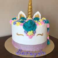 Unicorn Cake Triple layer torted vanilla cake with raspberry filling. Fondant ears, eyelashes and horn. Horn is a long strip of fondant wrapped around...