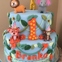 Baby'S First Zoo Birthday Baby's first birthday zoo themed. 2 tiers, fondant designs, toy animals