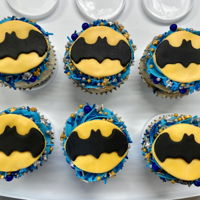 Batman Cupcakes Cupcakes with buttercream icing, sprinkles, and fondant decorations.