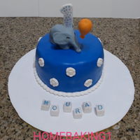 Elephant Cake chocolate cake covered in fondant elephant and balloon are fondant with added CMC