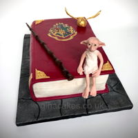 Harry Potter Spell Book Cake Harry Potter spell book cake with Dobby the golden snitch and the elder wand