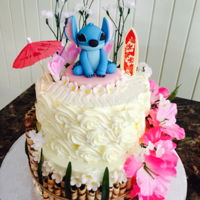 Lilo And Stitch Cake Two tiered Lilo and Stitch themed cake.