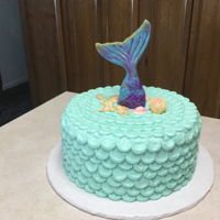 "Mermaid Cake This is a chocolate cake with buttercream ""scales"" icing. Fondant shells & mermaid tail. Made for a 50th birthday..."