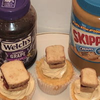 Peanut Butter And Jelly Cupcake Vanilla cupcake filled with jelly and frosting is vanilla with peanut butter on top is a tiny peanut butter and jelly sandwich