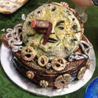 Steampunk Cake Super dark chocolate espresso cake covered in dark chocolate ganache and decorated with Scottish shortbread cookie ornaments