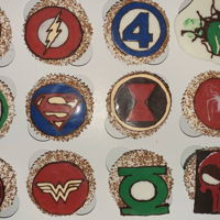 Superhero Cupcakes Chocolate espresso cupcakes with vanilla Swiss meringue buttercream, decorated with chocolate floodwork superhero badges