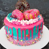 Girly Donut Cake A girly and colorful donut cake. Statement of the day: I love sprinkles!