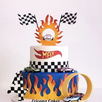 Hot Wheels Fire Flame Cake 2 tiered Hot wheels fire flame cake. Top tier is vanilla cake and bottom tier is red velvet cake. Cutter is available in etsy shop at https...
