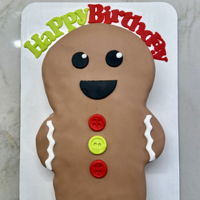 Gingerbread Man Cake Fondant covered cake with fondant decorations.