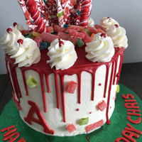 Candy Chaos! Vanilla cake with buttercream frosting, red chocolate drip. Assorted candy topping.