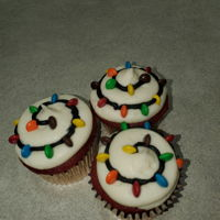 Christmas Lightstrand Cupcake red velvet cake with cream cheese icing, mini m&m's for the bulbs